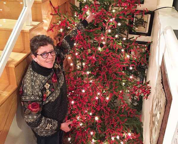 A red-yarn prayer tree for Advent