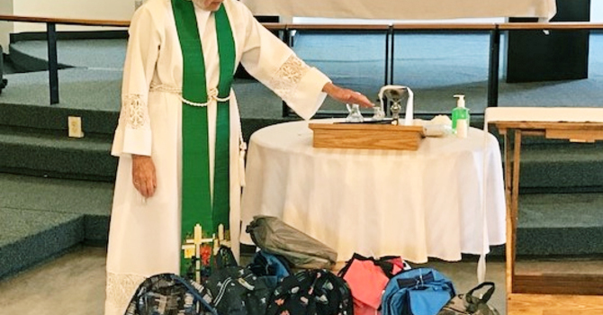 Holy Trinity Riverbend Offers Backpacks and Blessings  image