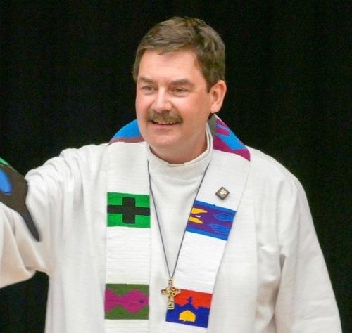 Rev. Andrew Comar