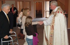 Bishop michael at abbotsford greets erica pearson with daughter jamie follwed by former mayor george ferguson on october 28