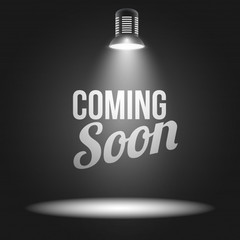 Coming soon message illuminated with light projector 1284 3622