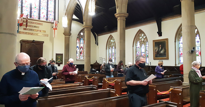 Small, socially-distanced group gathers for Cathedral service image
