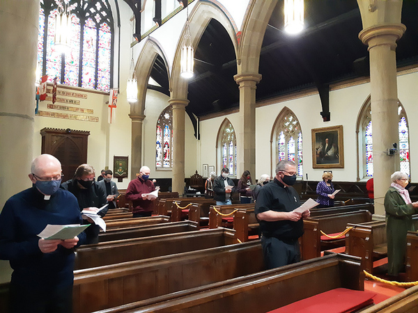 Small, socially-distanced group gathers for Holy Week service