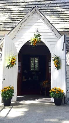 Sunflowers%20and%20marigolds%20decorate%20the%20entrance
