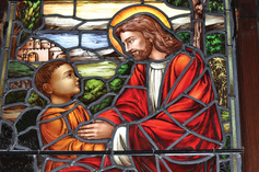 Close up of boy and jesus in centennial window