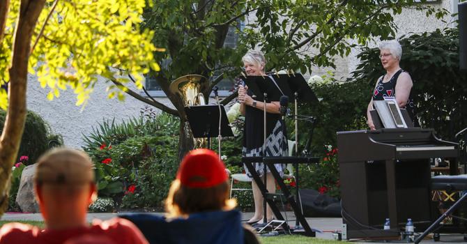 Joy Berg and Ann Salmon Make Soothing Music in Christ Church Garden