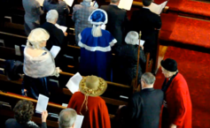 People in costume coming into worship