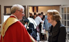 Bishop michael greets a parishioner after palm sunday worship 2